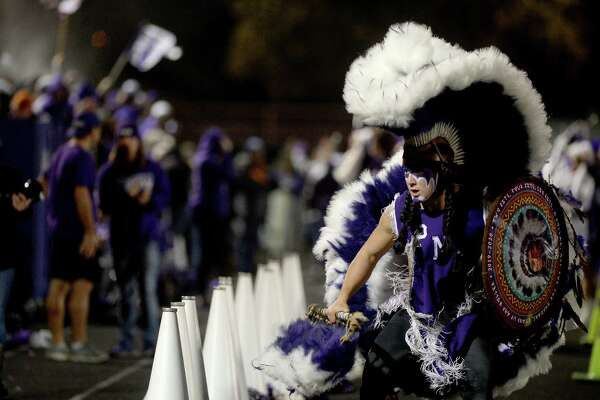 Port Neches - Groves' Indian Spirit celebrates on the sidelines as they score against Nederland during their mid-county match-up at Nederland. Photo taken Friday, November 8, 2019 Kim Brent/The Enterprise