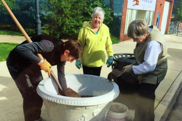 Beautification chairman Suzanne Lagomarcino, left, Carol Morris and Carol Woody preparing pots for flowers in Downtown Alton as part of the Alton Community Service League. This group has always been about community improvement and beautification, and for more than 60 years, it has been filled with members who take pride in the work that they and the organization put forth.