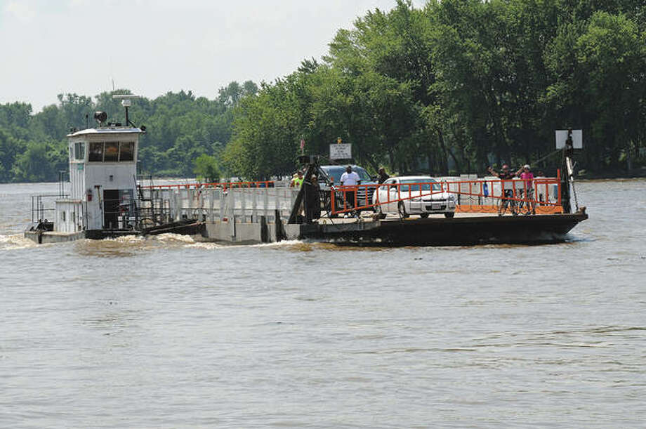The Grafton Ferry angles against the river current as it approaches the dock in Grafton.