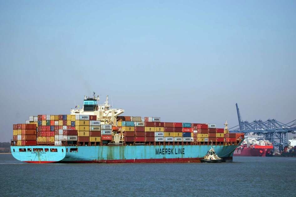 A Svitzer tug boat sits alongside the Maersk Gairloch container ship as it approaches the Port of Felixstowe, in Felixstowe, U.K., on March 25, 2020.