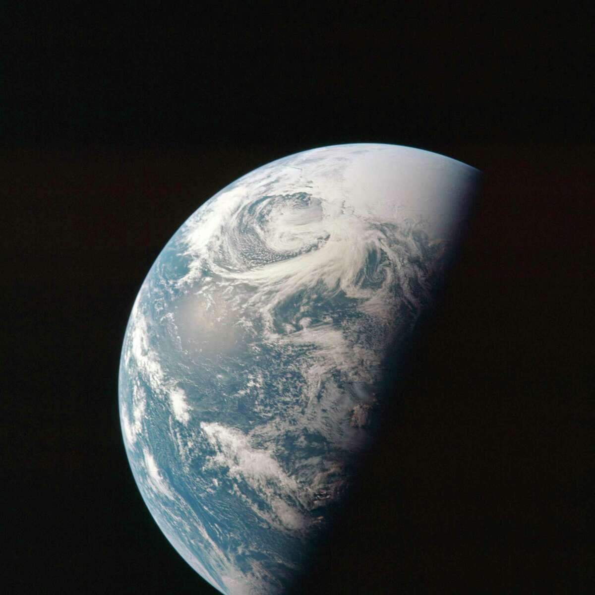 This April 1970 photo made available by NASA shows the Earth as the Apollo 13 mission heads toward the moon. (NASA via AP)