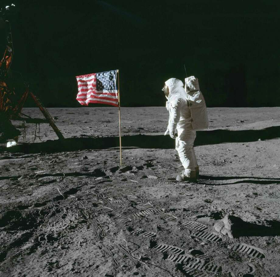 On July 20, 1969, astronaut Buzz Aldrin beside the deployed United States flag during Apollo 11 extravehicular activity on the lunar surface. The Lunar Module is on the left, and the footprints of the astronauts are clearly visible in the soil of the moon. Photo: NASA