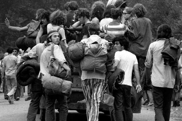 """The original caption to this photo, from the New York Daily News: """"They're Going Home Loaded. After a week of drugs and disappointment, youths abandon the Powder ridge ski area in Middlefield, Conn., yesterday. The rock festival, which had been scheduled, had long been canceled by court order. But 30,000 squatters had gone to site anyway. It turned out to be a bad trip."""""""