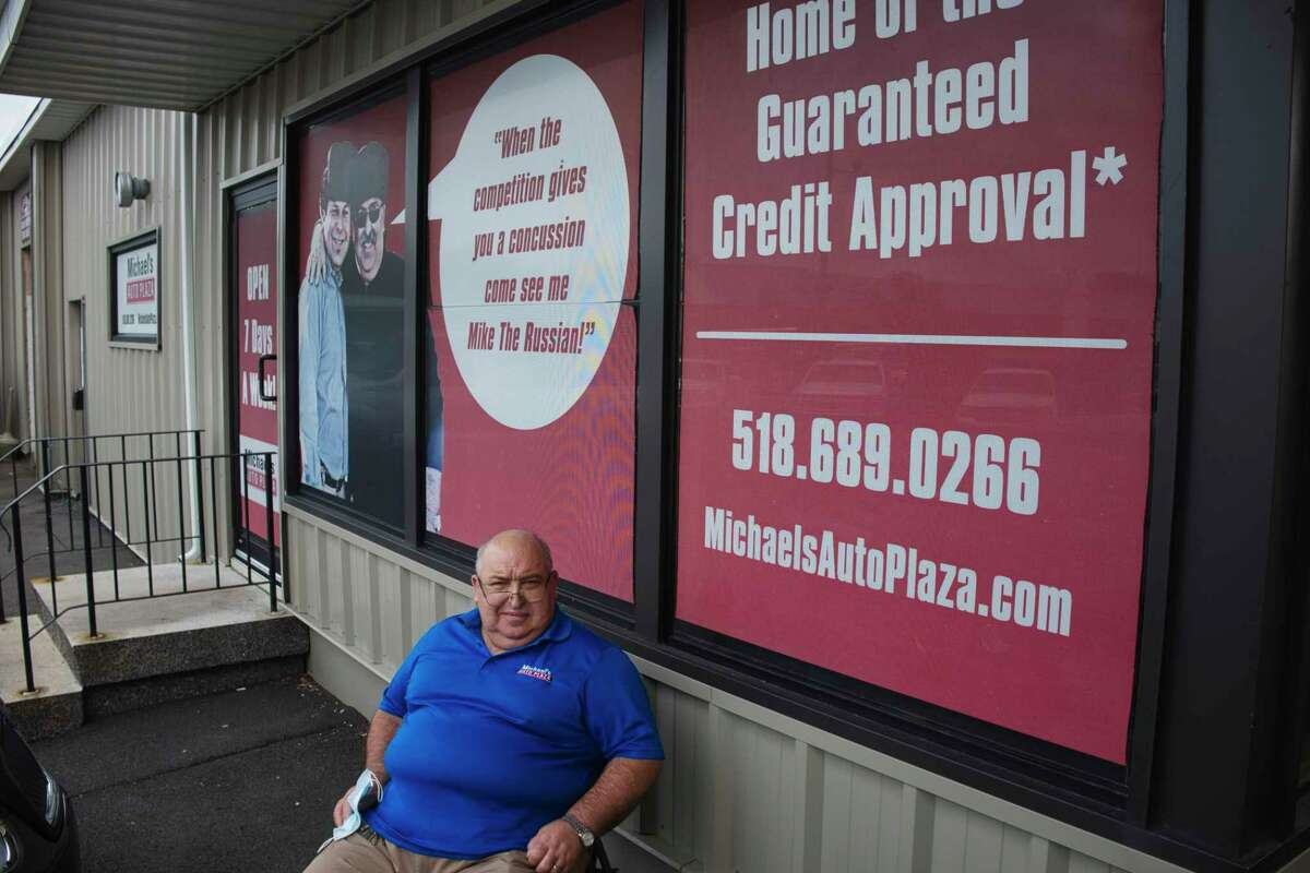 Michael Rubinchuk, owner of Michael's Auto Plaza, poses for a photo at his business on Tuesday, July 7, 2020, in East Greenbush, N.Y. (Paul Buckowski/Times Union)
