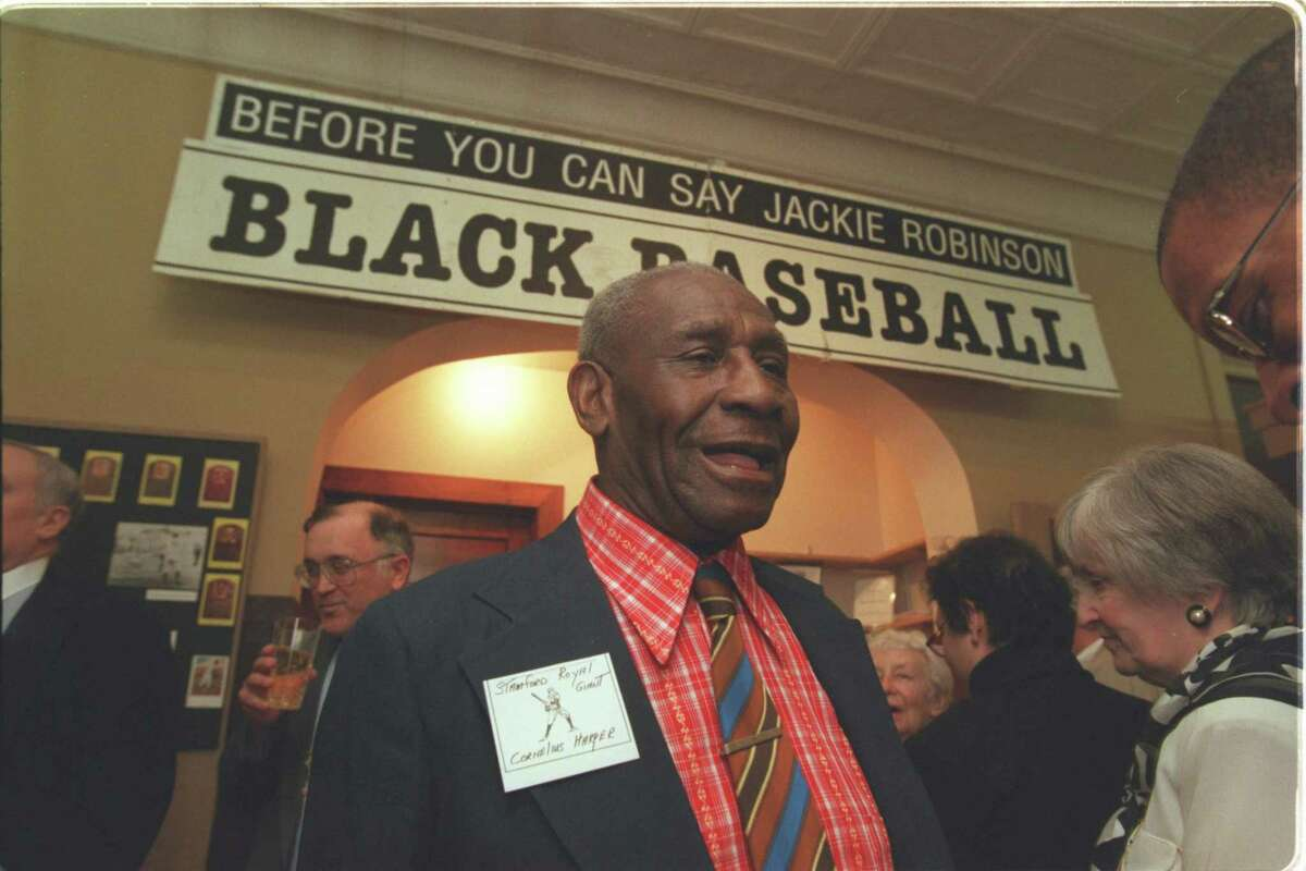 """Negro League baseball player Cornelius Harper, who played with the Stamford Royal Giants, chats during the opening of an exhibit titled """"Before You Can Say Jackie Robinson"""" at the Stamford Historical Society in 1998."""