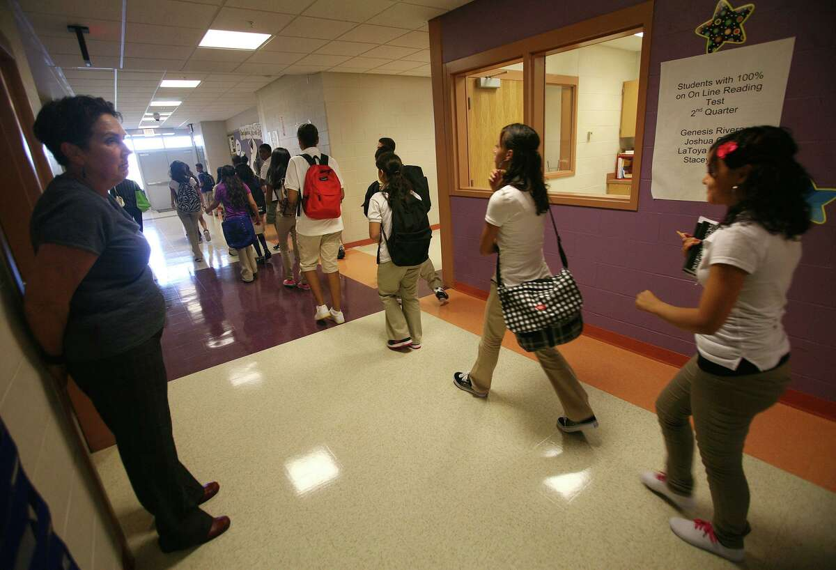 Principal Ann de Bernard looks on as an eighth-grade class files through the halls during the first day of school at Waltersville School in Bridgeport on Wednesday, Aug. 31, 2011.