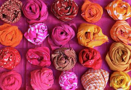 Anita Jaisinghani likes brightly colored scarves. Otherwise, she says, what's the point?