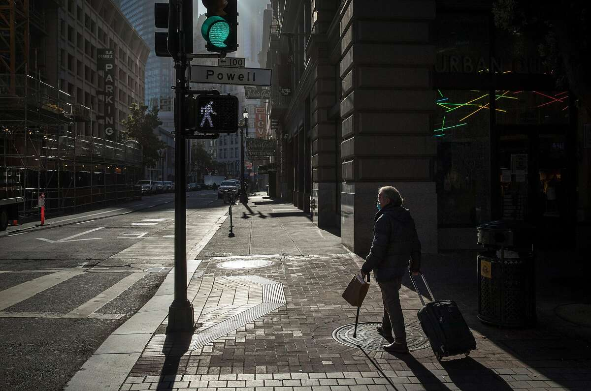 Juventino Barojas walks near Union Square after leaving Glide Memorial Church where he recieved breakfast in San Francisco. Calif., on Wednesday, May 27, 2020. Barojas, a former hotel worker who grew up in Puebla Mexico, is a homeless senior citizen and lives on the streets of the city during the coronavirus pandemic.