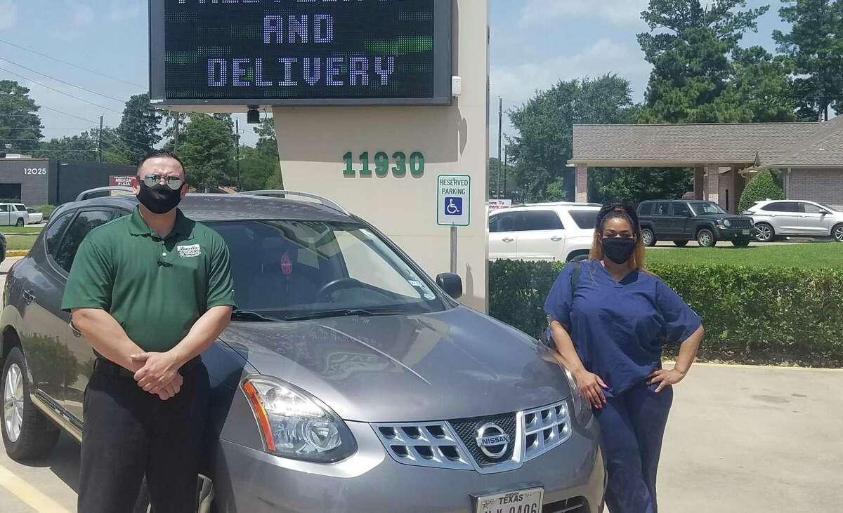 Houston Methodist Willowbrook Hospital nurse Necole Boudreaux receives a free set of new tires through Louetta Automotive's Honor Local Heroes program.