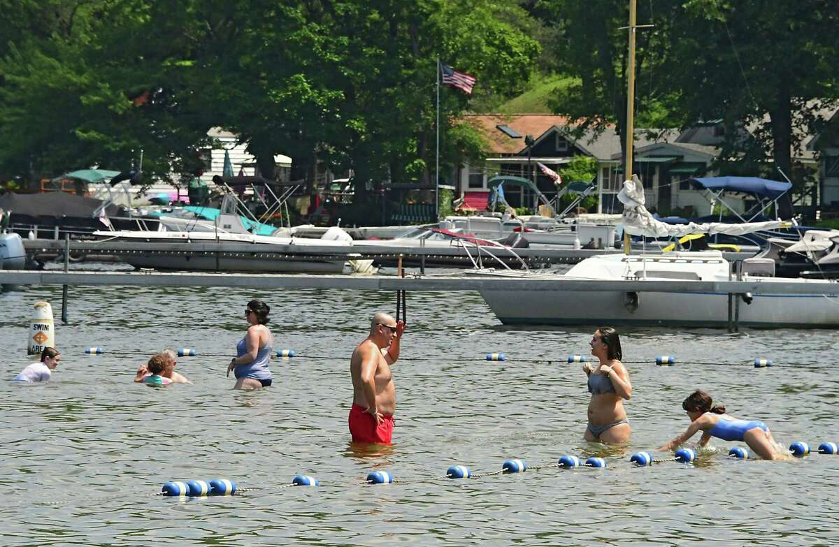 Pools and beaches can open with social distancing rules in place over Memorial Day weekend, Gov. Andrew M. Cuomo said Wednesday. His goal is for them to reach full capacity by the Fourth of July. Pictured: Swimmers keep cool during a heatwave by swimming at Brown's Beach on Thursday, July 9, 2020 in Saratoga Springs, N.Y. (Lori Van Buren/Times Union)