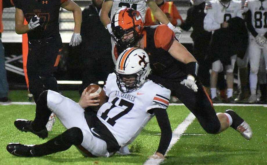 Edwardsville linebacker Jacob Morrissey chases down St. Charles East quarterback Nathan Hayes in the second quarter. Photo: Matt Kamp|The Intelligencer