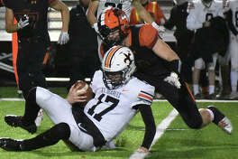 Edwardsville linebacker Jacob Morrissey chases down St. Charles East quarterback Nathan Hayes in the second quarter.