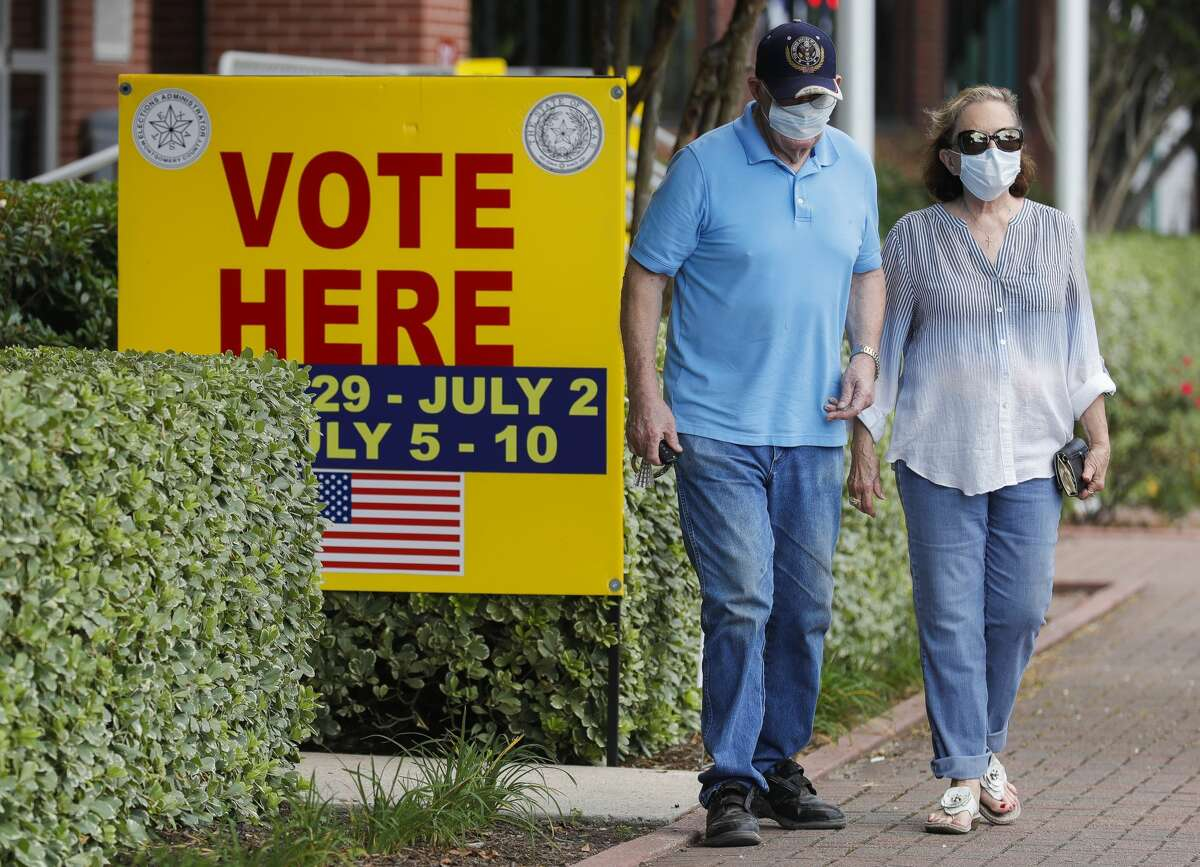 Residents leave the polling location at Lee G. Alworth Building after voting on the final day of early voting, Thursday, July 9, 2020, in Conroe.