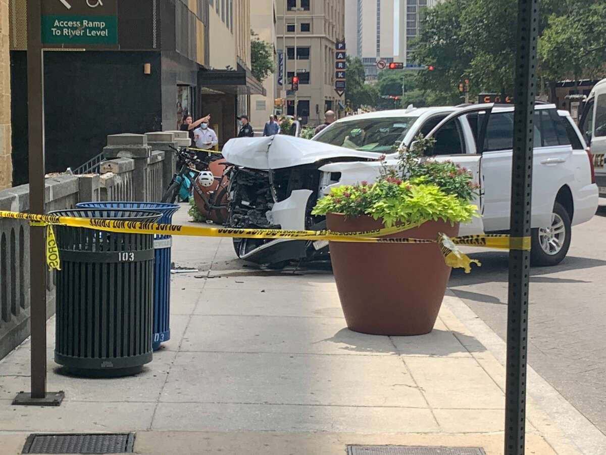 A vehicle appears to have crashed into a concrete barrier Thursday on a bridge over the River Walk downtown.