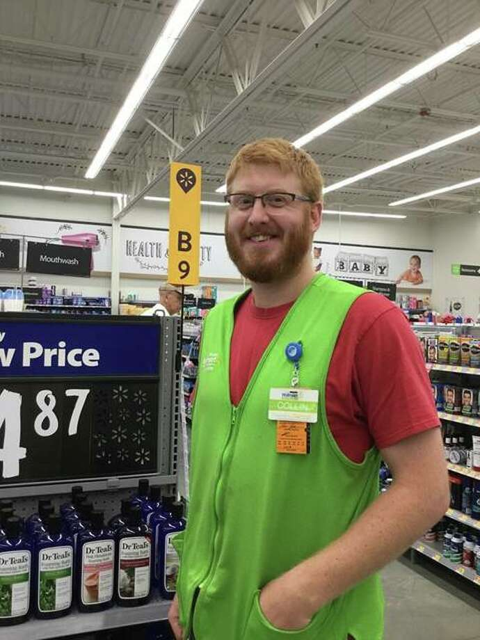 """Collinsville's Collin Fenton at his place of employment at Walmart in Collinsville. Fenton has been selected as a """"Snacktion Hero"""" from nearly 600 nominations submitted for local grocery store employees on the frontlines across the country, from Novato, California, to Clermont, Florida. He was nominated by Collinsville resident Nancy Staves. Photo: For The Intelligencer"""