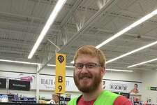 """Collinsville's Collin Fenton at his place of employment at Walmart in Collinsville. Fenton has been selected as a """"Snacktion Hero"""" from nearly 600 nominations submitted for local grocery store employees on the frontlines across the country, from Novato, California, to Clermont, Florida. He was nominated by Collinsville resident Nancy Staves."""
