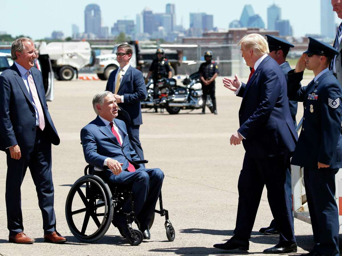 Texas Attorney General Ken Paxton and Gov. Greg Abbott, center, greet President Donald Trump as he arrives on Air Force One at Dallas Love Field, Thursday, June 11, 2020, in Dallas.(AP Photo/Alex Brandon)