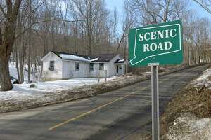 A neighborhood association opposes the plan by Writer's Institute of selling an 18-acre property to an unaffiliated church group. They believe that the church would represent much more traffic and disruption than the current use. Wednesday, March 11, 2015, in Danbury, Conn. A scenic road sign identifies Long Ridge Road as the only scenic road in Danbury.