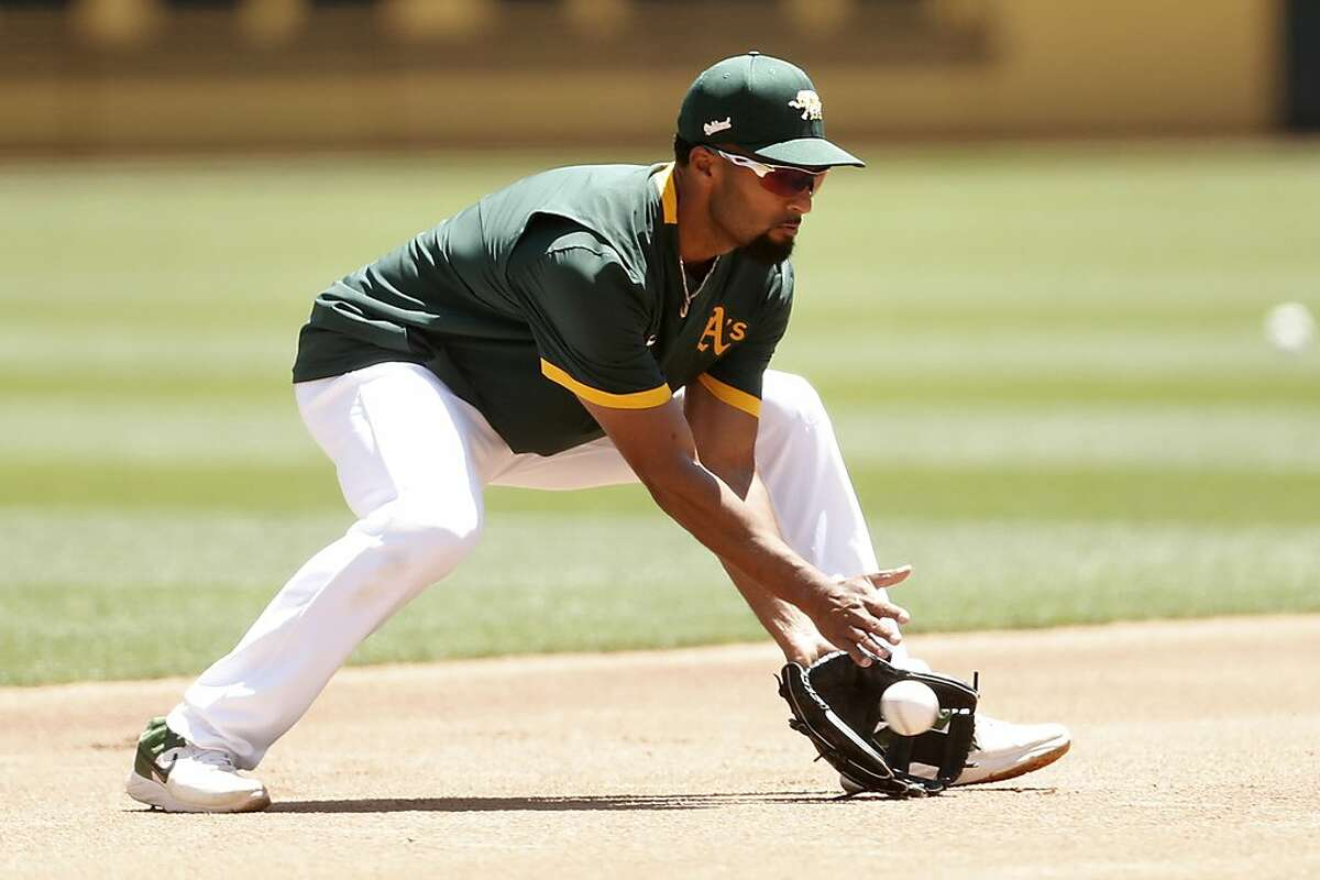 Oakland Athletics' shortstop Marcus Semien fields a grounder during practice at Oakland Coliseum in Oakland, Calif., on Wednesday, July 8, 2020.