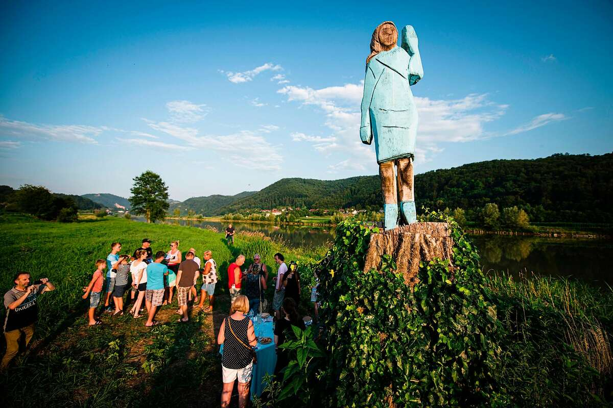 People gather around what conceptual artist Ales 'Maxi' Zupevc claims is the first ever monument of Melania Trump, set in the fields near the town of Sevnica, Slovenia, the U.S. first lady's hometown, during an inauguration celebration on July 5, 2019. (Jure Makovec/AFP/Getty Images/TNS)