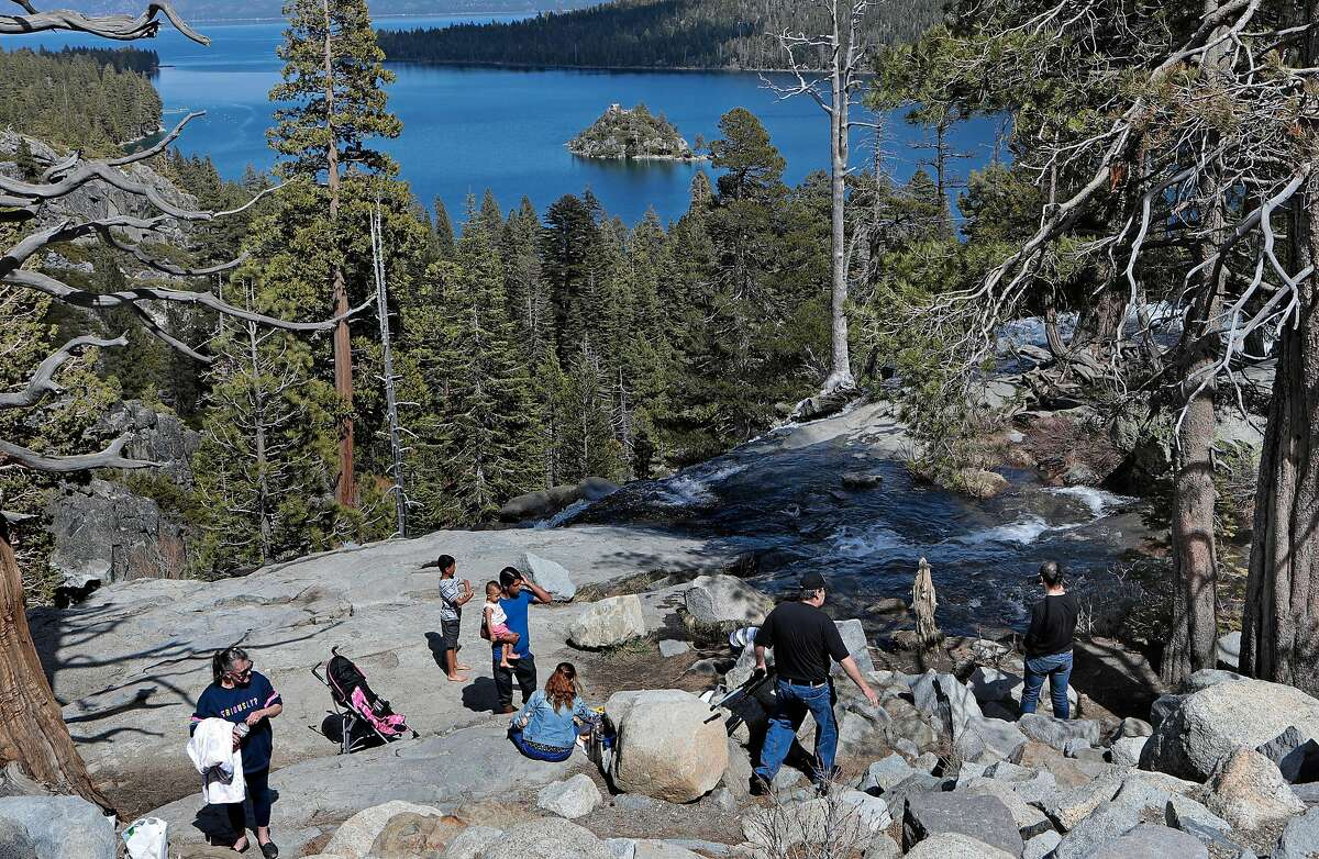 People gather at the Emerald Bay overlook in South Lake Tahoe, Ca., on April 23, 2020. El Dorado County supervisors plan to hold an emergency meeting Thursday to discuss the enforcement of rules to slow the spread of the coronavirus.