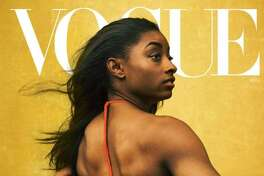 Champion gymnast Simone Biles wears a Bottega Veneta bodysuit. To get this look, try: Luminous Silk Foundation in 13, Eye & Brow Maestro in 1, Ecstasy Balm in 1. All by Armani Beauty. Hair, Nai'vasha Johnson; makeup, Fara Homidi. Photographed by Annie Leibovitz, Vogue, August 2020