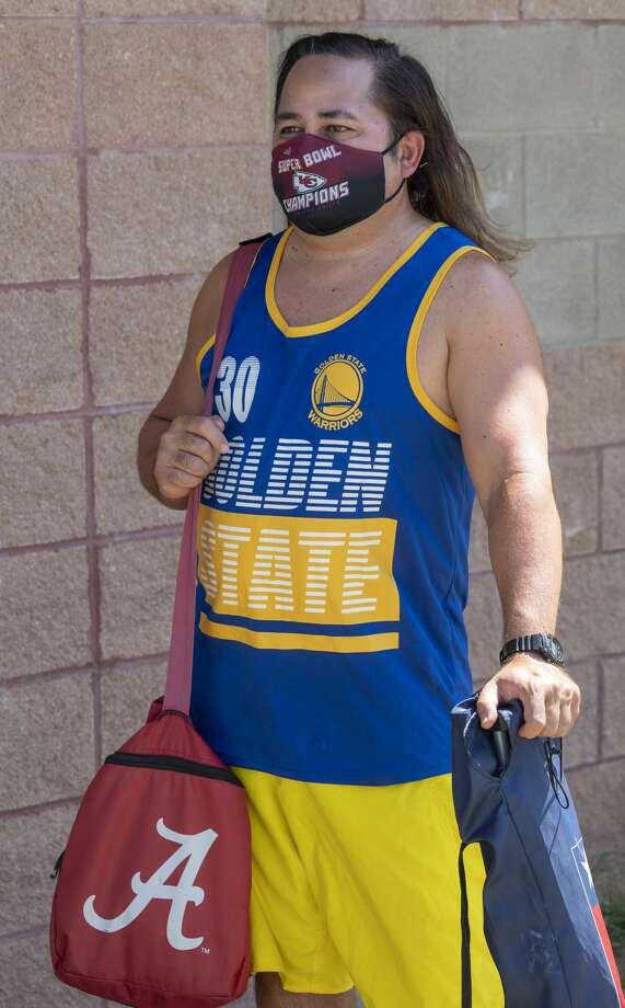 John Burton wears his mask as he waits in line 07/09/2020 to cool off at Doug Russell Pool. Tim Fischer/Reporter-Telegram Photo: Tim Fischer/Midland Reporter-Telegram