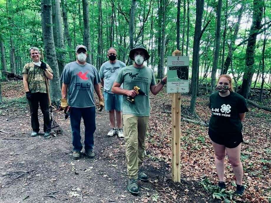 Rotarians Ruth Steele, Greg Biddinger, Saginaw Basin Land Conservancy member Trevor Lind, Dorrie Battel and Cass City Parks and Rec volunteered to clear trails in the village park, and added to the disc golf course. (Courtesy Photo)