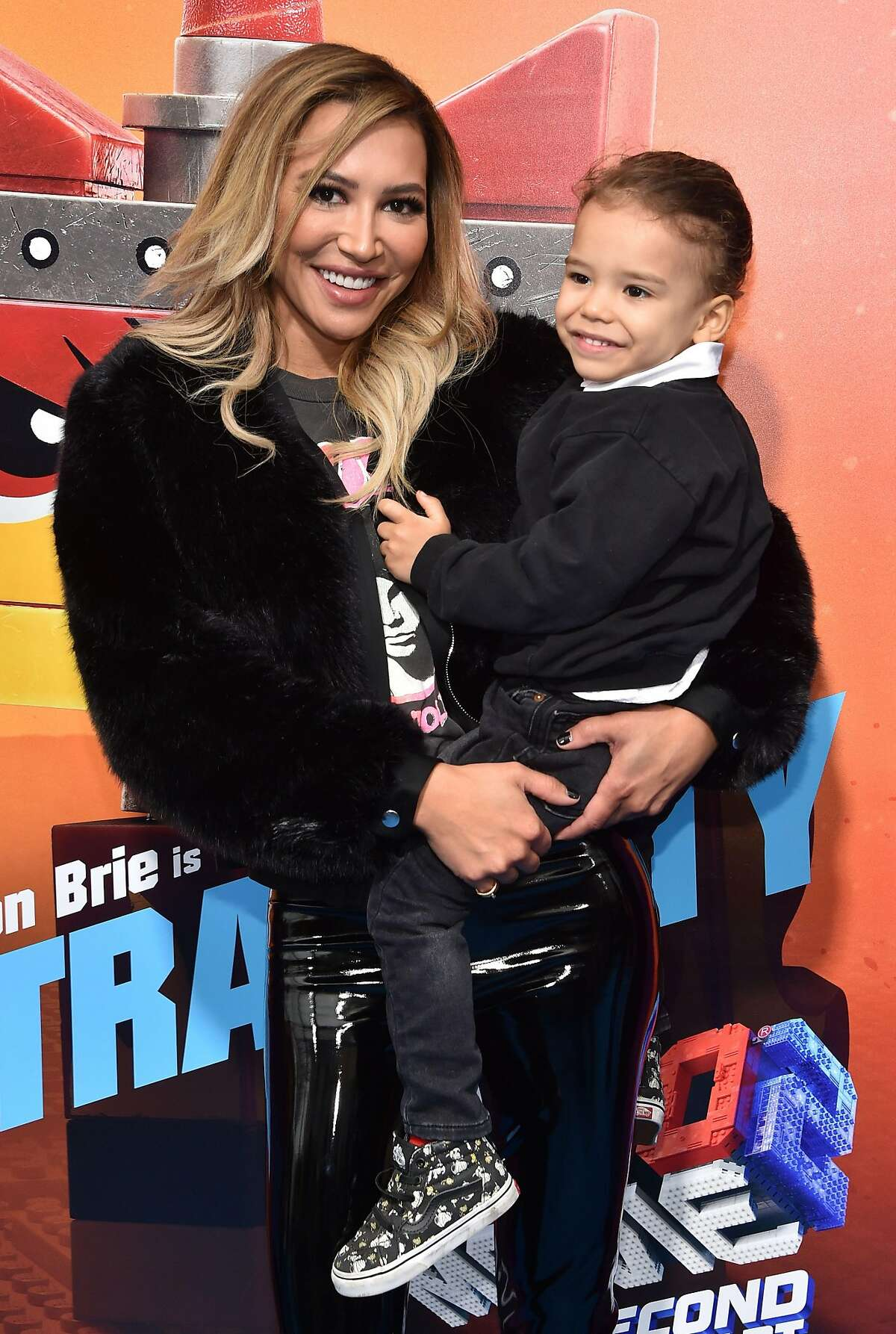 """(FILES) In this file photo US actress Naya Rivera and son Josey Hollis Dorsey arrive for the premiere of """"The Lego Movie 2: The Second Part"""" at the Regency Village theatre on February 2, 2019 in Westwood, California. - """"Glee"""" star Naya Rivera is missing and feared drowned at a California lake, local officials said, with rescuers to continue a search for her on July 9, 2020.The Ventura County Sheriff's office earlier tweeted it was looking for a """"possible drowning victim"""" at the lake, and said a dive team was being deployed to the area.Rivera, 33, is best known for her role as high school cheerleader Santana Lopez in """"Glee"""", the TV series she starred in for six seasons. (Photo by Chris Delmas / AFP) (Photo by CHRIS DELMAS/AFP via Getty Images)"""