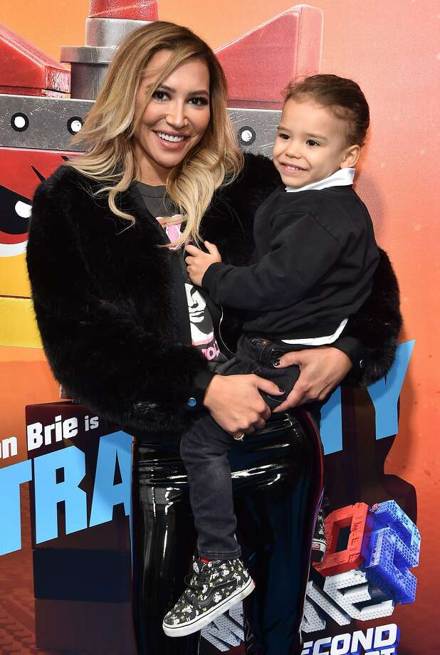 "(FILES) In this file photo US actress Naya Rivera and son Josey Hollis Dorsey arrive for the premiere of ""The Lego Movie 2: The Second Part"" at the Regency Village theatre on February 2, 2019 in Westwood, California. - ""Glee"" star Naya Rivera is missing and feared drowned at a California lake, local officials said, with rescuers to continue a search for her on July 9, 2020.The Ventura County Sheriff's office earlier tweeted it was looking for a ""possible drowning victim"" at the lake, and said a dive team was being deployed to the area.Rivera, 33, is best known for her role as high school cheerleader Santana Lopez in ""Glee"", the TV series she starred in for six seasons. (Photo by Chris Delmas / AFP) (Photo by CHRIS DELMAS/AFP via Getty Images) Photo: Chris Delmas, AFP Via Getty Images"