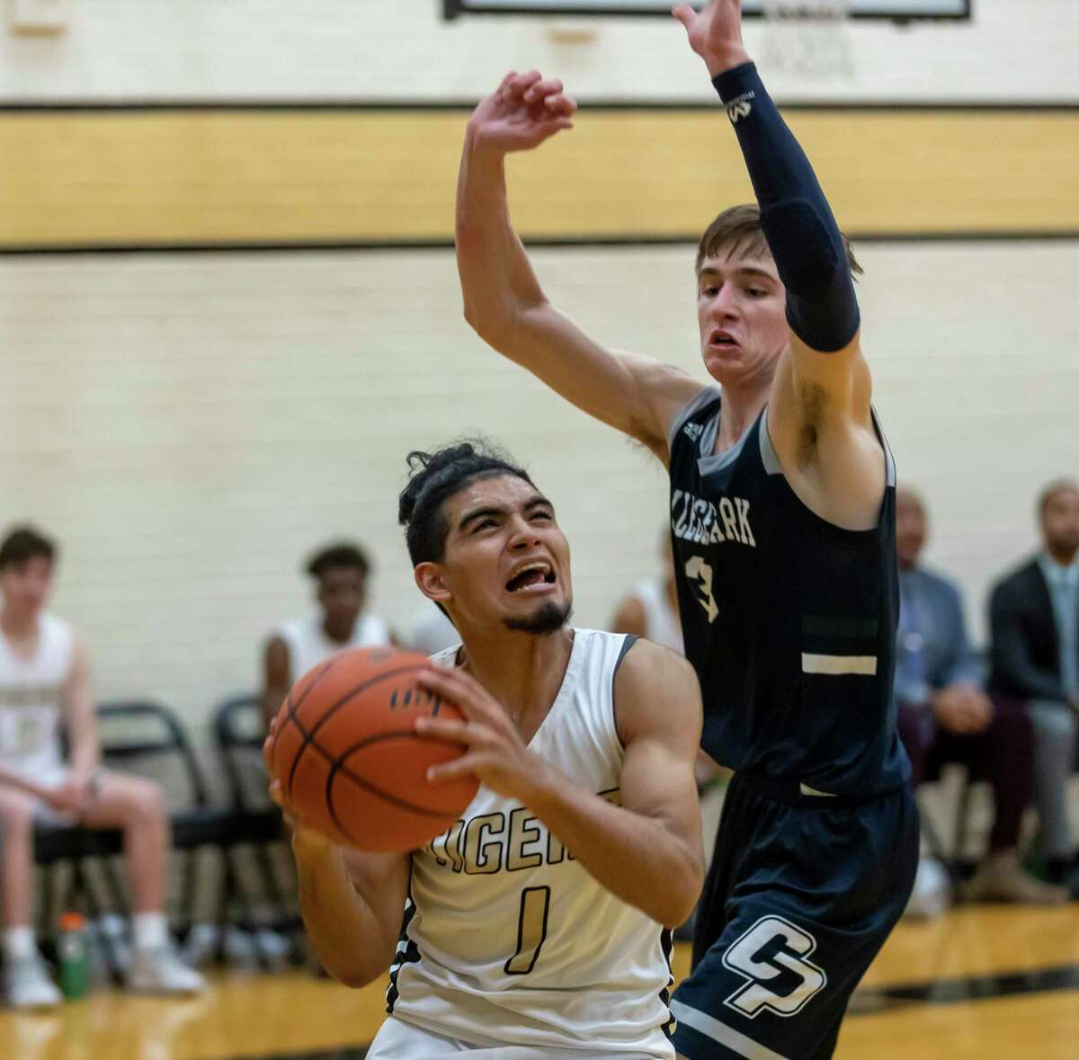 Conroe player David Sanchez (1) shoots for the basket while under pressure from College Park guard Drew Calderon (3) during the second half in a District 15-6A boys basketball game in The Pit on Friday, Feb. 14, 2020.