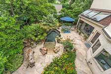 Here's an aerial view of the home's gorgeous backyard tropical retreat.