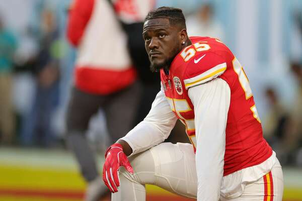 MIAMI, FLORIDA - FEBRUARY 02: Frank Clark #55 of the Kansas City Chiefs knees before in Super Bowl LIV at Hard Rock Stadium on February 02, 2020 in Miami, Florida. (Photo by Maddie Meyer/Getty Images)