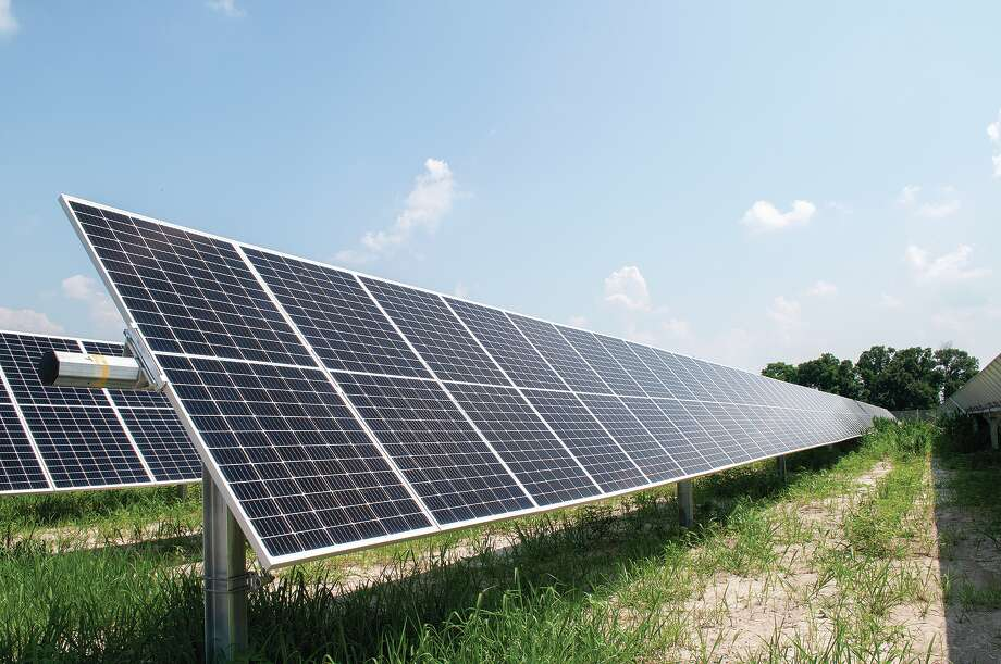 A solar panel collects sunlight, which it will convert into electrical energy that can travel along the existing power grids to be used in homes and businesses. Photo: Darren Iozia / Jacksonville Journal-Courier