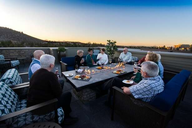 The rooftop deck at the Alexander in Bend, Oregon features multiple fire pits and some of the most beautiful views in the Pacific Northwest of the surrounding mountain ranges.