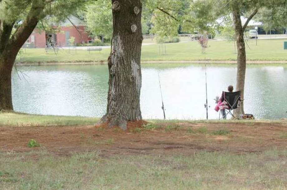 Glazebrook Pond, seen in this file photo, was the subject of several discussions this week at the Godfrey Village Board ranging from the need to raise the water level because of new nearby artificial turf soccer fields to people overfeeding fish in the pond.