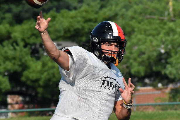 Edwardsville quarterback Ryan Hampton delivers a pass during Thursday morning's practice inside the District 7 Sports Complex.