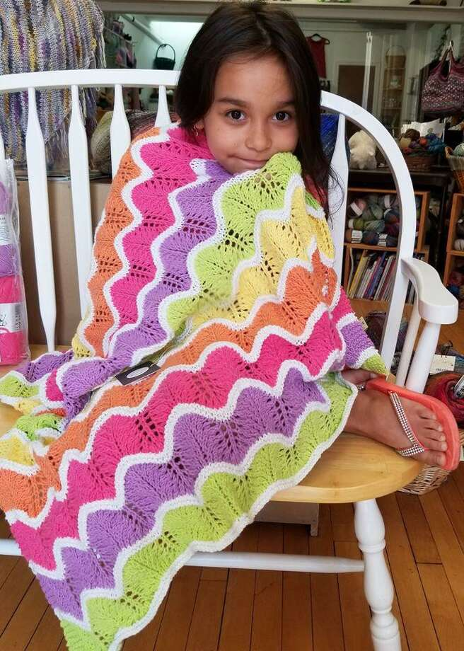 This blanket which comes as a kit, is also available in pretty subtle pastels. My granddaughter Aariana agrees. Photo: Ginger Balch / Contributed Photo