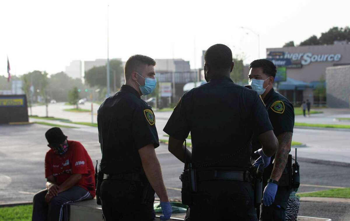 Houston Police Department Crisis Intervention Response Team Officer Richard Pietruszynski, left, talk to the officers who secured the scene where an individual has mental health issues Thursday, July 2, 2020, in Houston. The person, who has mental health history, had been drinking straight vodka for more than 12 hours when the police arrived the scene. In Houston and Harris County, social workers have been part of the police response for more than a decade, partnering with patrol officers to respond to mental health crises and domestic violence calls.
