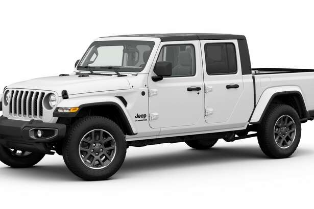 A black Freedom hardtop is standard on Gladiator Altitude while the dual top is an available option.