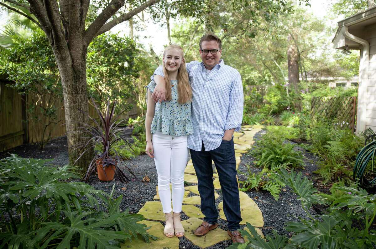 Ellie Peterson, left poses for a portrait with her dad, Matt Paterson, near their home in The Woodlands, Tuesday, July 7, 2020. Ellie Peterson, a John Cooper School graduate, was awarded the Insperity Scholarship and was nominated by her dad.