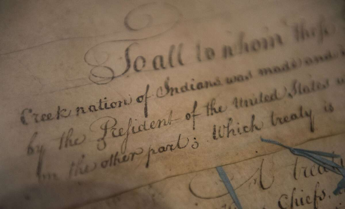 FILE - This March 16, 2015, photo shows a detail of the 1790 Treaty of the Muscogee (Creek) Nations and the United States on display at the Smithsonian's National Museum of the American Indian
