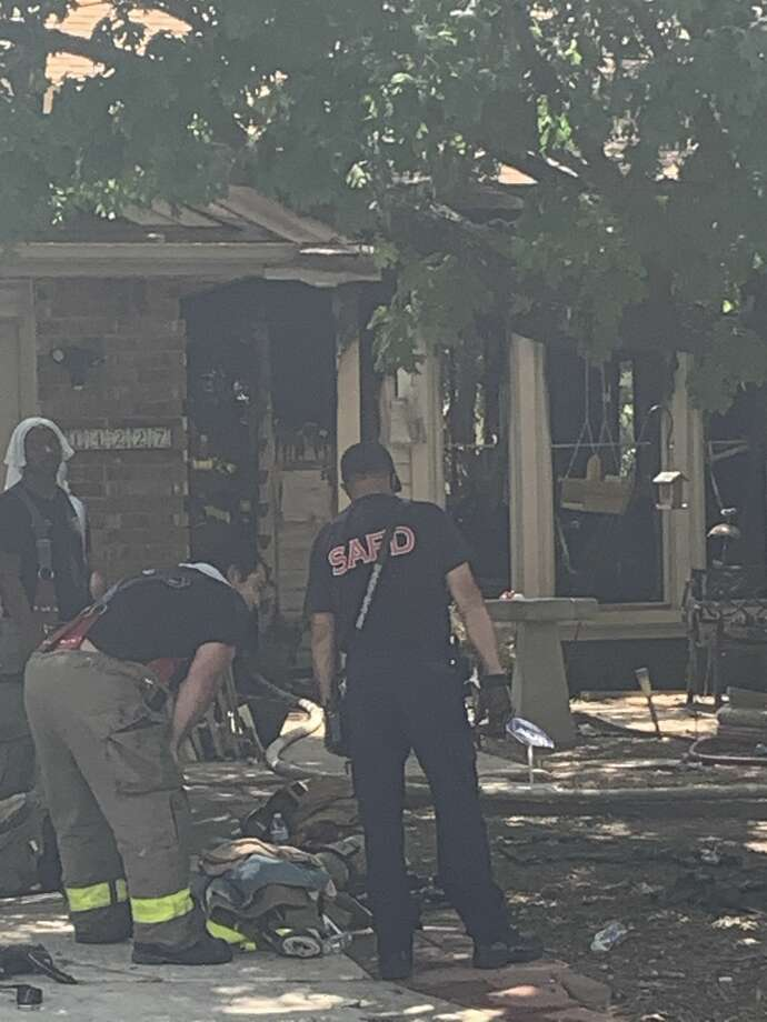 San Antonio firefighters rescued six animals from a burning home on the North Side on Thursday. Photo: Taylor Pettaway