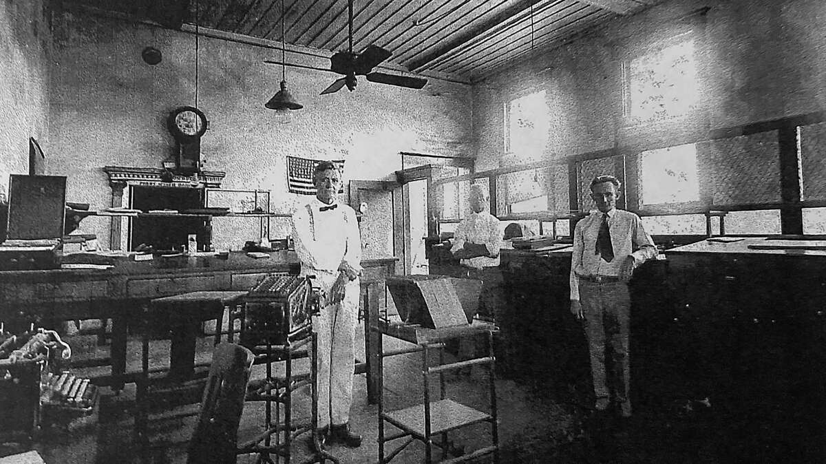 """A.W. """"Alf"""" Morris Jr., left, is pictured in Conroe's First State Bank in the early 1900s. Alf Morris was a cashier in the bank and went on to hold several elected offices in Montgomery County including as County Judge. His descendants remain active in Conroe today."""