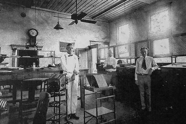 "A.W. ""Alf"" Morris Jr., left, is pictured in Conroe's First State Bank in the early 1900s. Alf Morris was a cashier in the bank and went on to hold several elected offices in Montgomery County including as County Judge. His descendants remain active in Conroe today."
