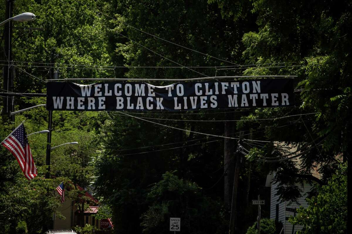 A banner in support of Black Lives Matter has been erected along Main Street in tiny Clifton, Va.