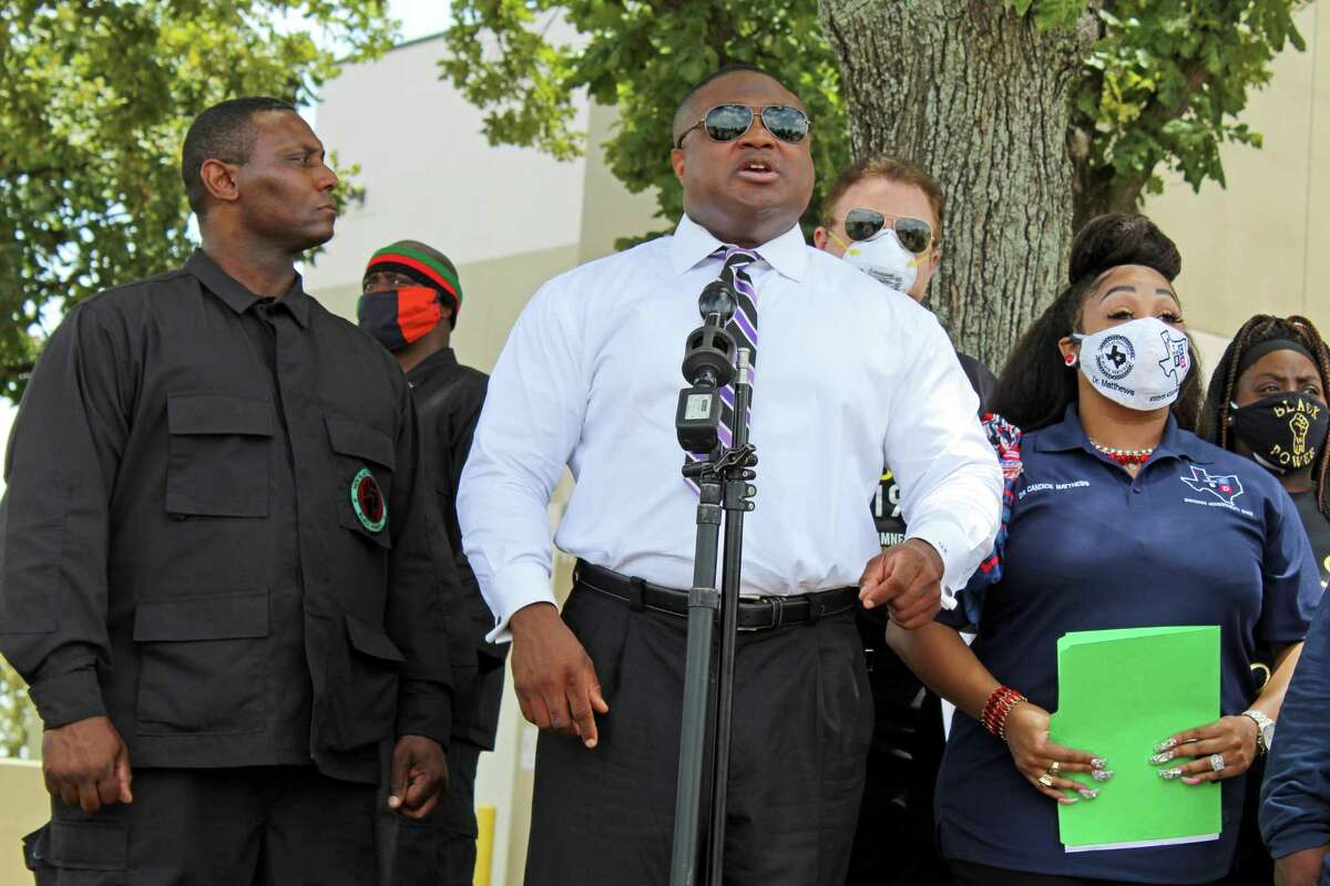 Community activist Quanell X speaks at a protest outside the early voting poling location at Missouri City City Hall Wednesday, July 8.