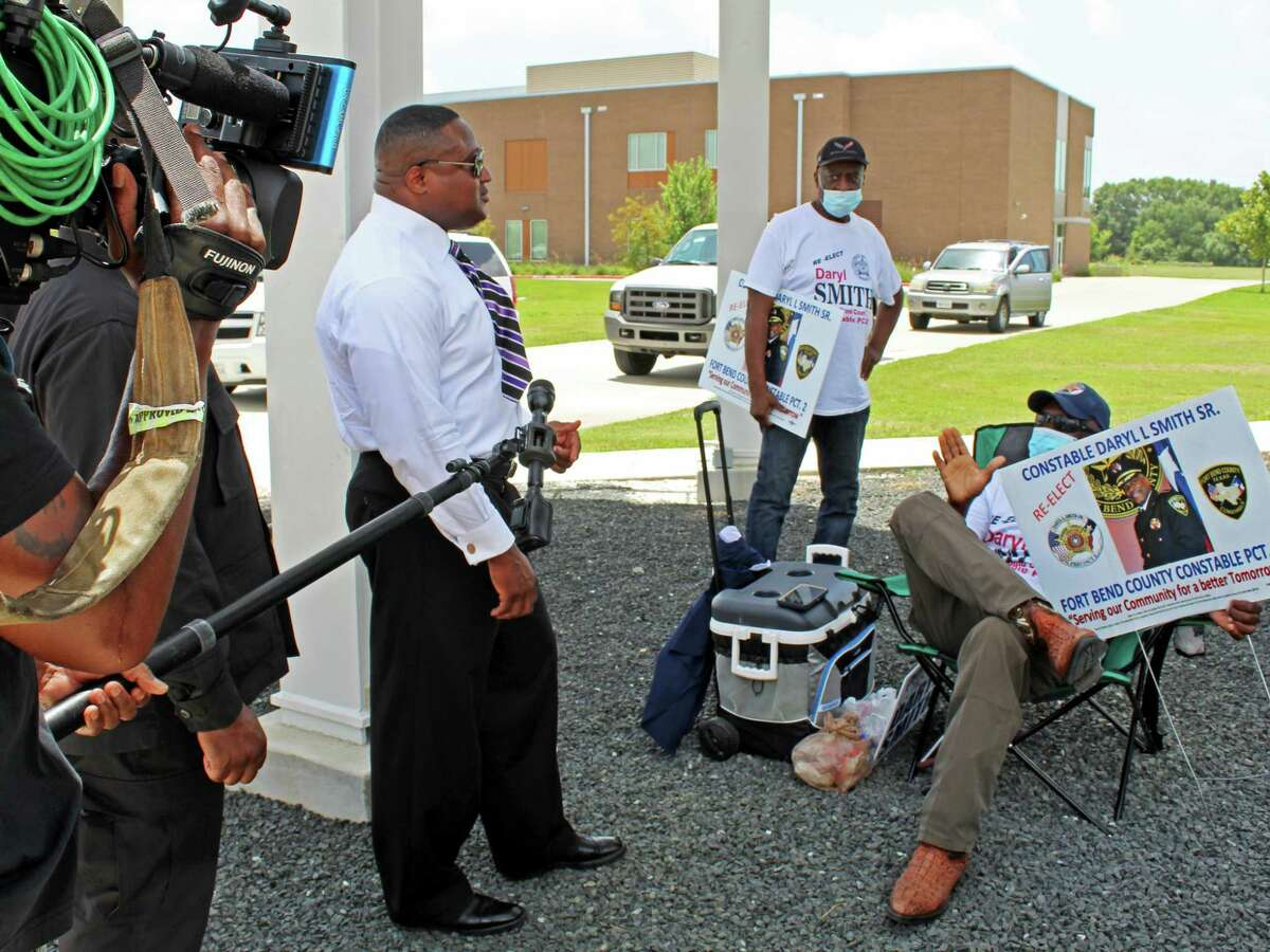 Community activist and protest supporters confronted Constable Daryl Smith, who was at the Missouri City early voting polling location Wednesday, July 8.
