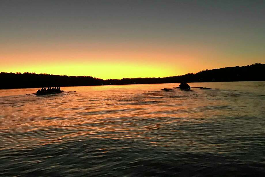 The UConn women's rowing team works out on Wangumbaug Lake in this September 2019 photo taken in Coventry Lake. The school's decision to cut the program is designed to help cut by $10 million the school's $43 million athletic department deficit as it deals with falling revenue during the COVID-19 pandemic. Photo: Jen Sanford / Via Associated Press / Jen Sanford