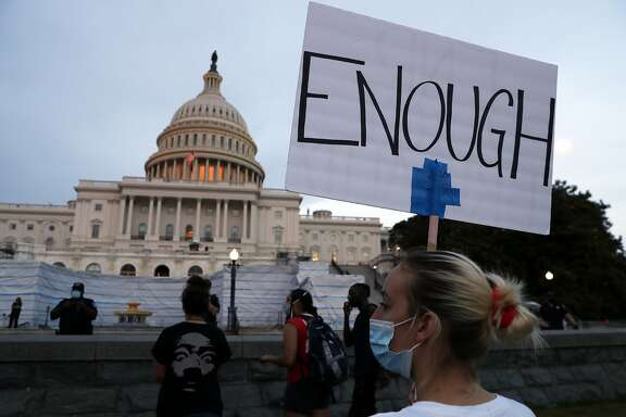 FILE - In this June 3, 2020, file photo, demonstrators protest the death of George Floyd, Wednesday, June 3, 2020, at the U.S. Capitol in Washington. It's rare for public opinion on social issues to change sharply and swiftly. And yet in the wake of George Floyd's death, polling shows dramatic movement in Americans' opinions on police brutality and racial injustice.  (AP Photo/Jacquelyn Martin, File)